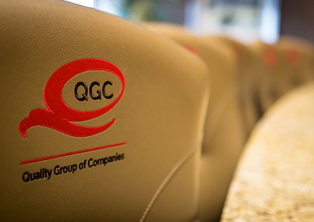 Stitched QGC logo on the back of conference room chairs